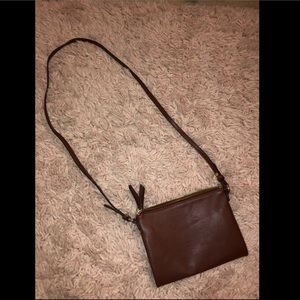 A pho brown leather purse.